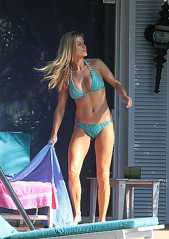 Joanna Krupa enjoying a sunny day in blue bikini at the pool in Miami Beach