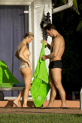 Joanna Krupa topless poolside paparazzi shots in Miami