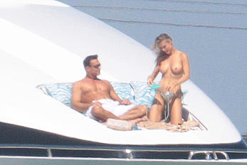 Joanna Krupa goes topless on a yacht in Miami