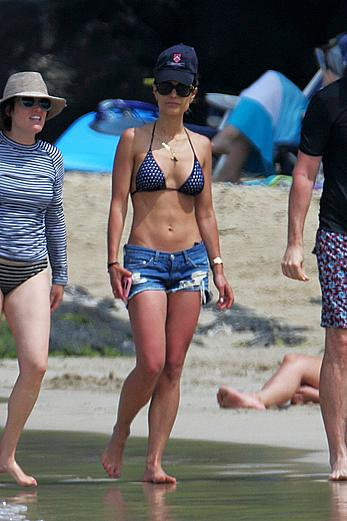 Jordana Brewster in bikini top and denim shorts at a beach in Hawaii