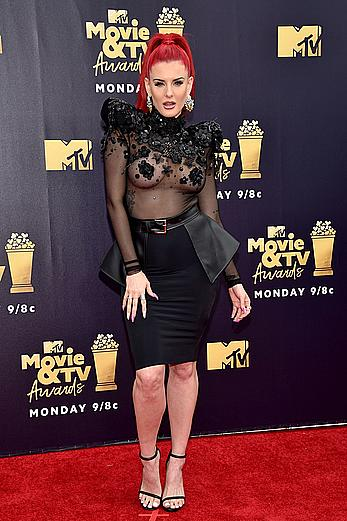Justina Valentine posing braless in see through dress at the MTV Movie & TV Awards