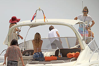 Kate Hudson in white bikini on a boat in Ibiza