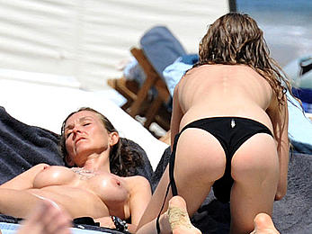 Katharina Damm swimming topless in St. Tropez