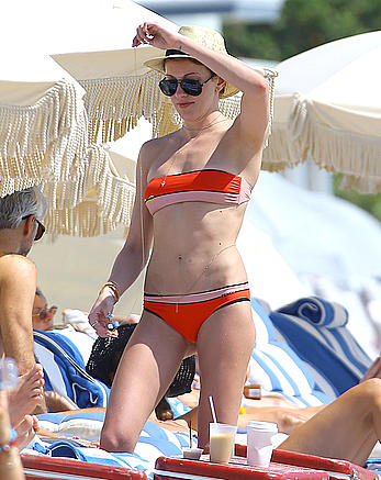 Katie Cassidy in red bikini on the beach candids