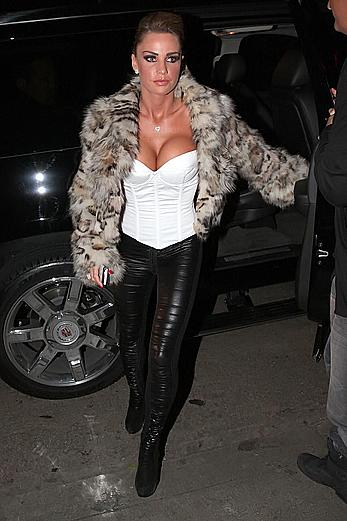 Busty Katie Price shows deep cleavage in the car