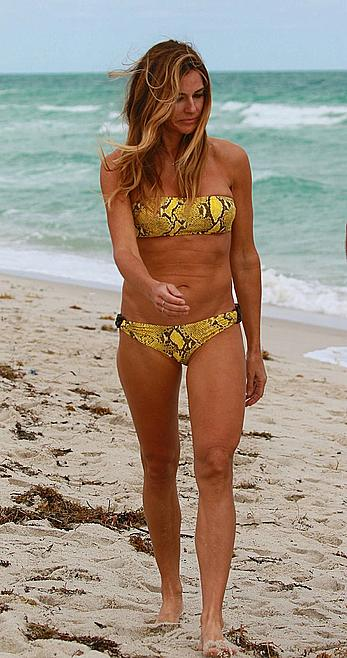 Kelly Bensimon in bikini on a beach in Miami