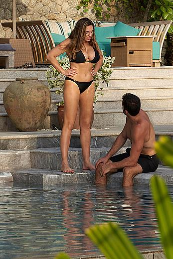 Busty Kelly Brook deep cleavage in black bikini in South East Asia