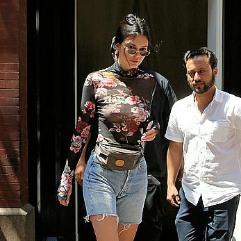 Kendall Jenner goes shopping in Soho in see through top and denim shorts
