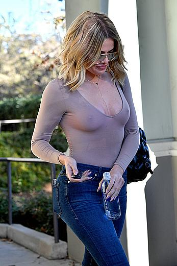 Khloe Kardashian braless under tight top shows pokies