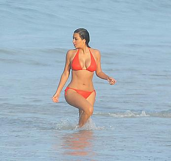 Kim Kardashian in red bikini candids on vacation in Mexico