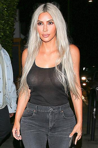 Kim Kardashian in see through black top without bra