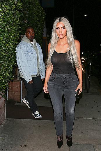 Kim Kardashian in see through black top without bra