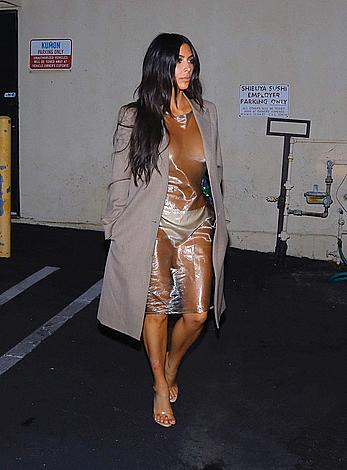Kim Kardashian in see through dress looks like a whore in Calabasas
