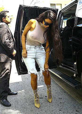 Kim Kardashian out braless in see through tight top in Miami