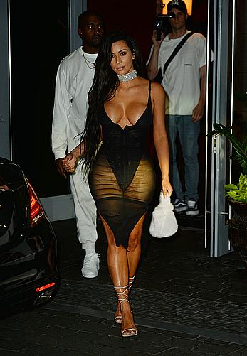 Kim Kardashian looking sexy in sheer lingerie in Miami