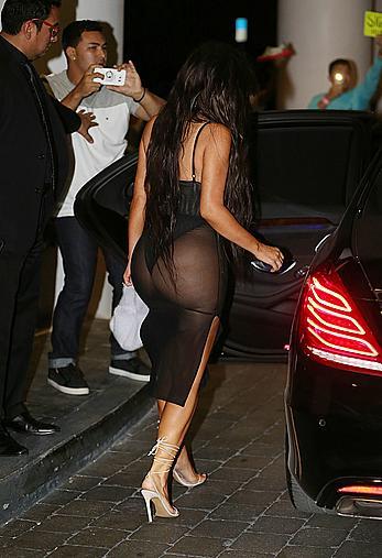 Kim Kardashian looking sexy in sheer lingerie in Miami