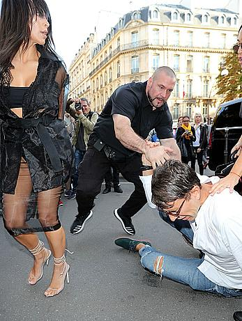 Kim Kardashian has her ass kissed by journalist Vitalii Sediuk in Paris