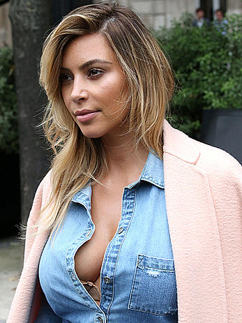 Kim Kardashian reveals cleavage for lunch in Paris