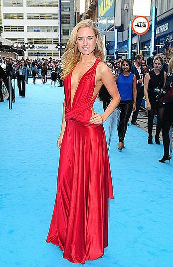 Kimberley Garner in red dress at premiere in London, shows side of boob