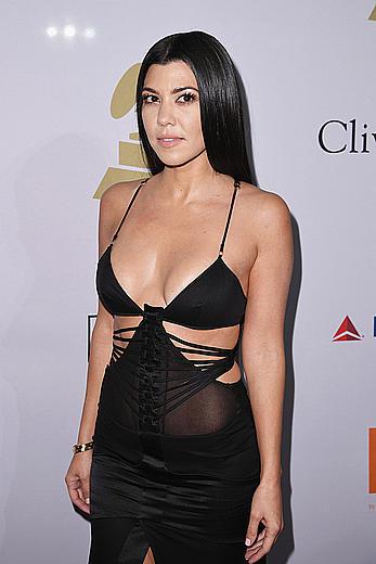 Kourtney Kardashian cleavage at Clive Davis Pre-Grammy in LA