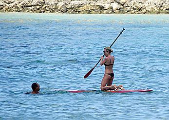 Kristin Cavallari in a bikini paddle boarding in Bali