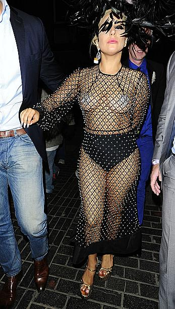 Lady Gaga topless with pasties under fishnet dress in London