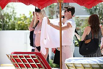Lara Stone seen topless during a swimwear photoset on Miami Beach