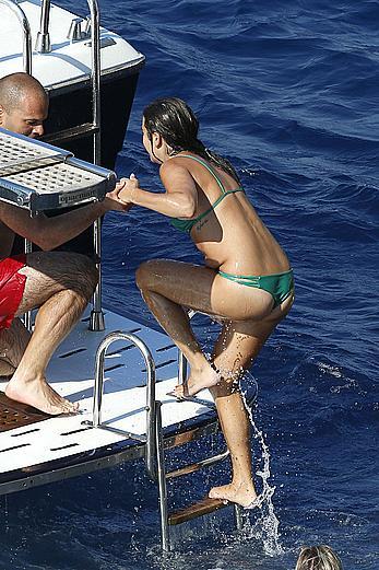 Lea Michele nipple slip in green bikini on a boat in Italy