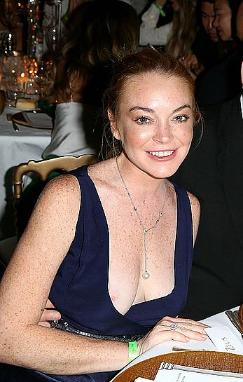 Lindsay Lohan nipple slip at birthday party in Porto-Cervo