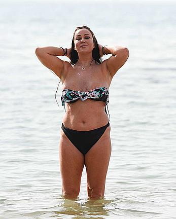 Lisa Appleton nipple slip on a beach in Spain