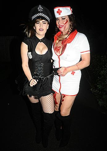 Lisa Appleton flashes her nude boobs in bloody nurse-costume at Halloween Party