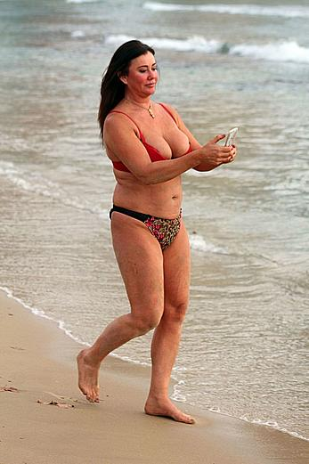 Reality star Lisa Appleton nipple slip on a beach in Spain