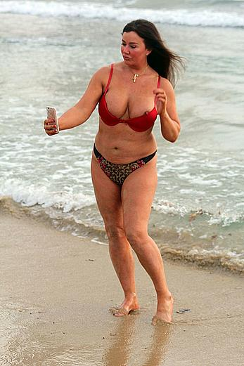 Reality star Lisa Appleton nipple slip on a beach in Spain