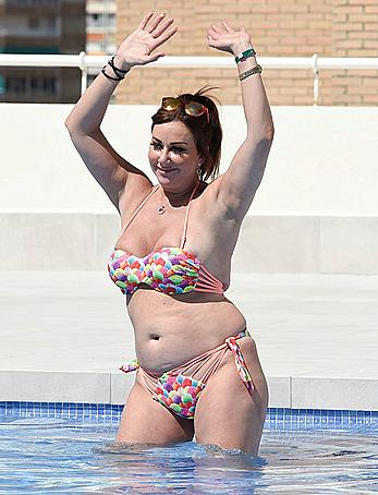 Lisa Appleton boobs out in a pool paparazzi shots