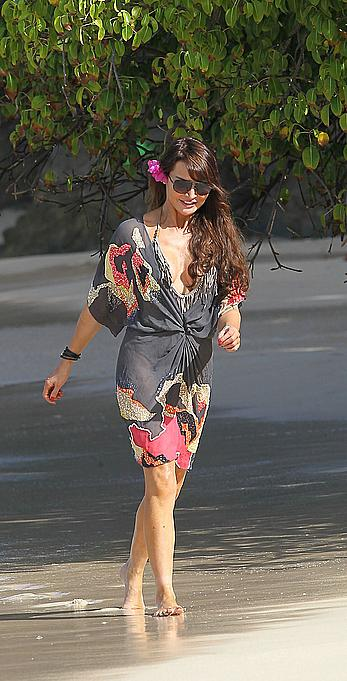 Lizzie Cundy wearing a one-piece swimsuit in Barbados