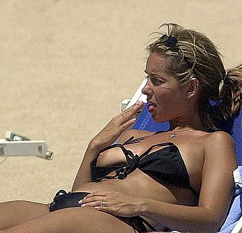 Louise Redknapp sunbathing topless on a beach