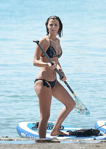 Lucy Mecklenburgh paddleboarding in black bikini in Miami