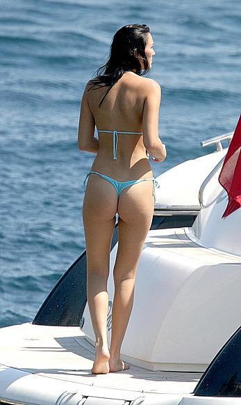 Lucy Clarkson topless in blue bikini pants on a yacht in Majorca