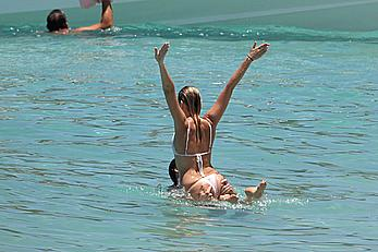 Margot Robbie sexy in white bikini on a beach in St. Barts with boyfrend