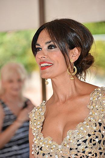 Maria Grazia Cucinotta shows deep cleavage at the 70th Venice International Film Festival