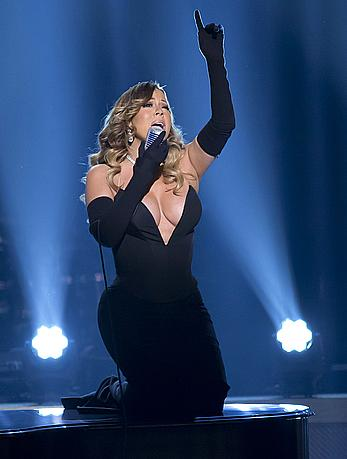 Mariah Carey deep cleavage in black dress while performs at The BET Honors-Washington DC at Warner Theater