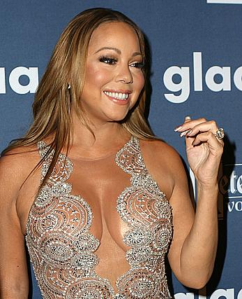 Mariah Carey posing in see through dress at 27th GLAAD Media Awards