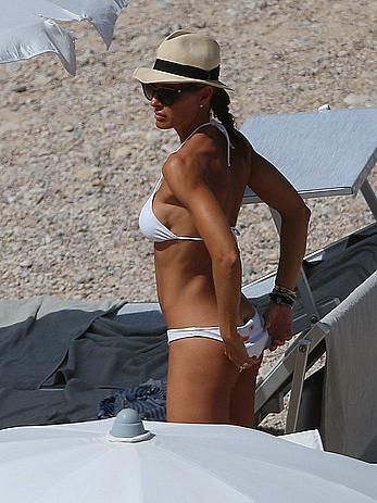 Martina Colombari topless on a beach in Ibiza