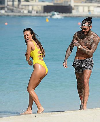 Megan McKenna in yellow bikini on a beach in Dubai