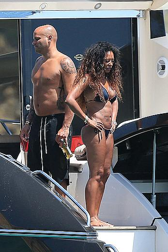 Melanie Brown in black bikini & hard nipples In ibiza