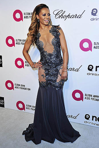 Melanie Brown slight cleavage at Elton John AIDS Foundation Academy Awards Viewing Party in LA