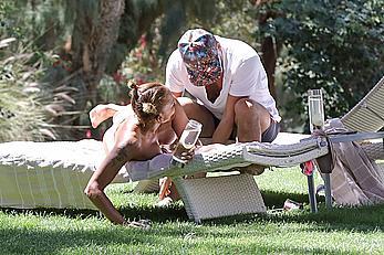 Melanie Brown topless at a resort in California