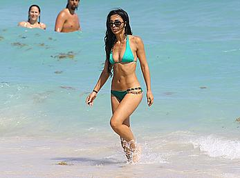 Metisha Schaefer in green bikini on a beach