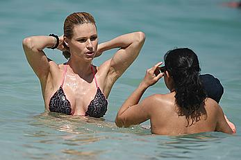 Michelle Hunziker in bikini at a beach