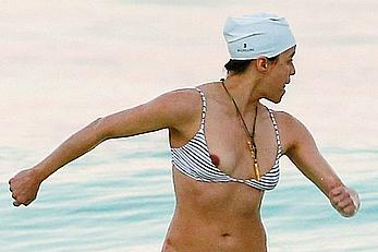 Michelle Rodriguez nipple slip on a beach in Mexico
